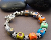 Reserved - Hippie Chick Colorful Bracelet - Lampwork Glass Bead with Balinese Sterling Silver