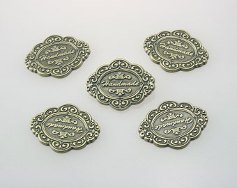 5 pcs. Zinc Antique Brass Vintage Handmade Label Tags Sewing Labels Charms Decorations 33x26 mm. Tag HM Br 3326 50 CHM RC