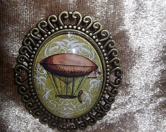 Steampunk Antique Bronze Tone Brooch Featuring Victorian Airship design Glass Cabochon