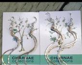 FREE SPIRIT swirl earrings. hammered, twirl, dainty, mixed metal