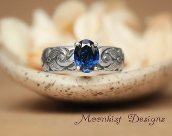 Oval Blue Sapphire Ring with Wide Scroll Pattern Band in Sterling - Silver September Birthstone Ring with Bold Scroll and Flower Band
