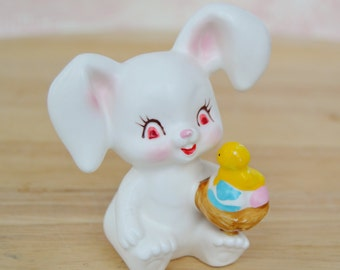 Vintage Easter Bunny Holding a Chick and Eggs Figurine by Napcoware