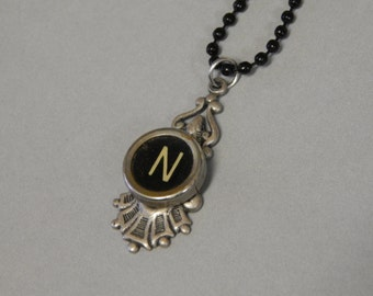 Typewriter key necklace, letter N on black key, silver toned pendant, with black bead chain