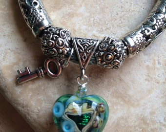Lamp work bead heart, pewter and silk ribbon necklace