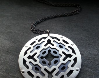 Geometric Collaboration Pendant - sterling silver and copper - Handcrafted Sacred Geometry Jewellery