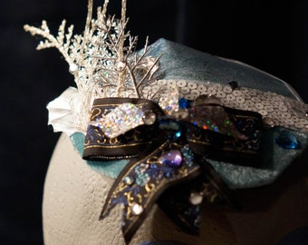 Elsa from Frozen inspired Fascinator / Hat with icy loveliness in blues and white snowy colors