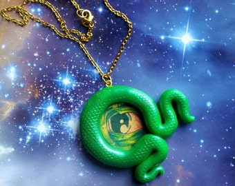 Green scaly tentacle and eye necklace