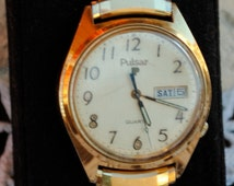 Vintage Men's Gold Pulsar Watch with Date