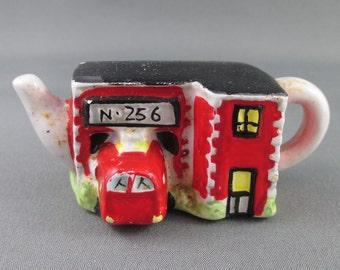 Red Rose Tea Figurine Fire Station Teapot Roseville