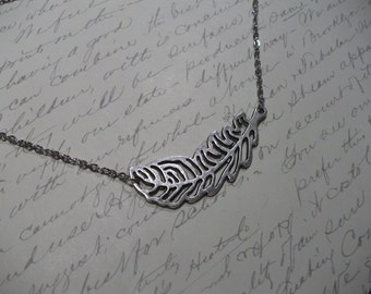 Large feather charm necklace