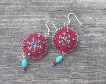 Dangling felt earrings beaded and embroidered with snowflakes