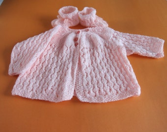 Hand knitted baby jacket set with booties