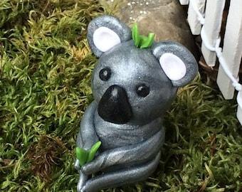 Baby Koala Figurine with Eucalyptus Leaves