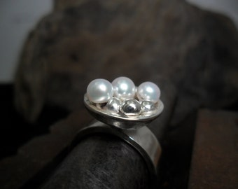 Sterling silver ring decorated with beads