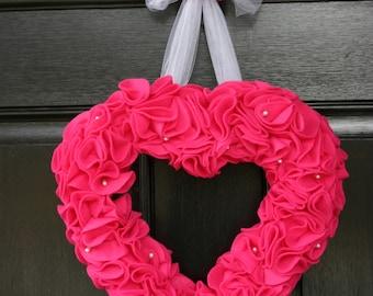 Bright pink felt heart wreath