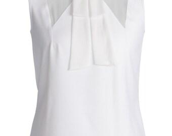 White top, chiffon details