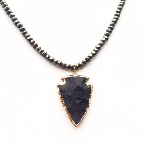Beaded necklace obsidian arrowhead pendant.