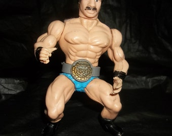 MUSTACHE WRESTLER GUY  Vintage Wrestling Action Figure with Belt and Afro Hair and Blue Underwear