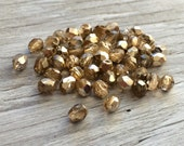 Czech glass faceted round firepolish beads champagne gold 4mm  pack of 50