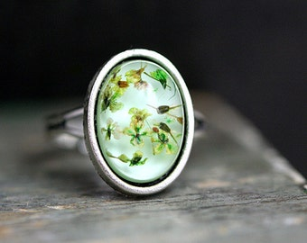 SALE 40% OFF: Dainty ring with real blossoms. Dried flowers in light turquoise resin and ...