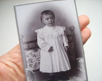 Child portrait little girl with earrings short hair white dress Antique old Cabinet Portrait CDV photograph studio beautiful steampunk