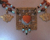 Boho Tribal twist makes repurposed statement necklace pop with turquoise, red jasper beads and cast brass cicadas.