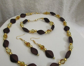 Brown Oval Acrylic Bead with Amber Glass Bead and Gold Spacer Necklace, Bracelet and Earrings