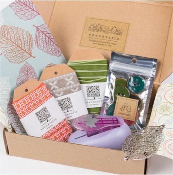 A curated + themed craft box of unique and high quality craft supplies - velvet ribbon, trim, buttons, embellishment, pendant, craft punch