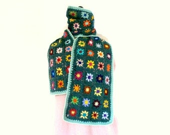 Scarf crochet granny multicolored flowers on green background