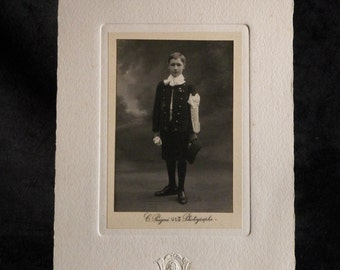Old photograph of a young boy dressed in clothes of communicant by Constant comb workshop photographer (1834-1916) | France
