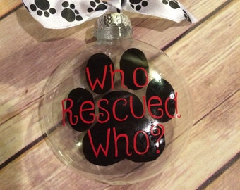 Who rescued who? Dog pawprint christmas Ornament; dog rescue ornament; dog lover ornament