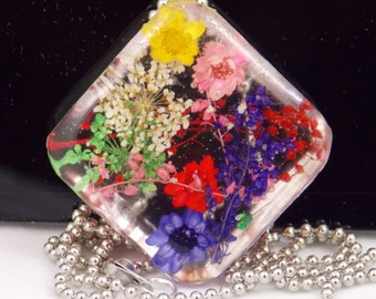 Multi Floral resin pendant necklace, different colored, different types of flowers makes this a unique necklace, diamond orientation, gift