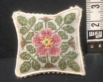 Mini pillow with pink embroidery