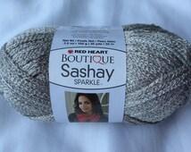 PLATINUM Sashay Sparkle Ruffle Scarf Yarn  /  RedHeart Boutique Sashay Sparkle Mesh Yarn