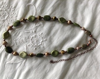 Green stone, copper, and resin beads