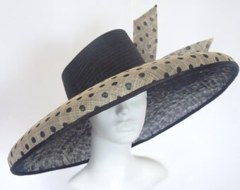 Very chic wide brimmed hat. Perfect for big occasions.
