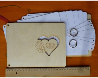 Wooden photo album with hearts, heart tendrils for weddings, birthdays, memory books for guests.