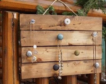 Jewelry Organizer. This rustic jewelry hanger comes with 8 distinctive knobs and an English Chestnut finish