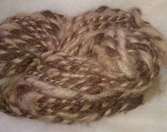 Bulky funky yarn: alpaca and wool blend, hand spun. Shades of natural brown, chocolate and golden. 120g approx