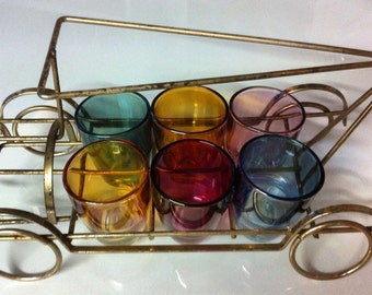 6 coloured 'shot' glasses in metal framed rickshaw