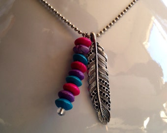 Necklace adorned with a silver leaf and wood beads.