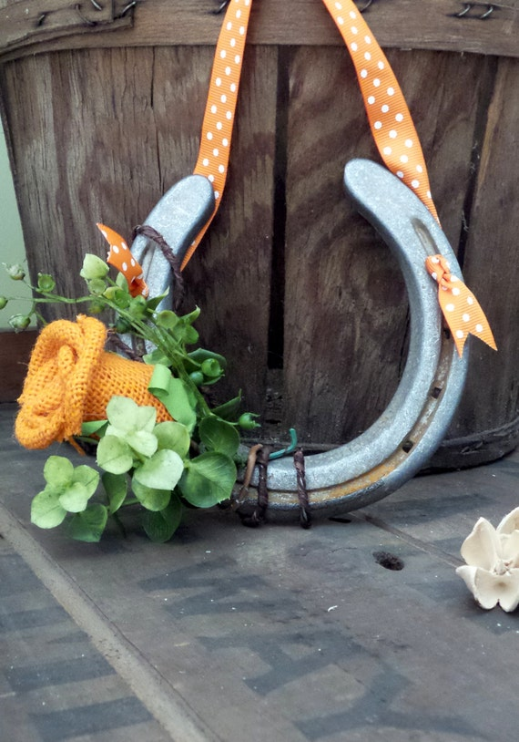 Bathroom Decor Featuring Horseshoes : Hanging horseshoe decor featuring orange burlap by