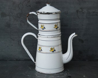 Vintage French enamelware coffee pot, jug,  with pretty yellow floral decor,  circa 1930. The coffee pot has a filter and lid.