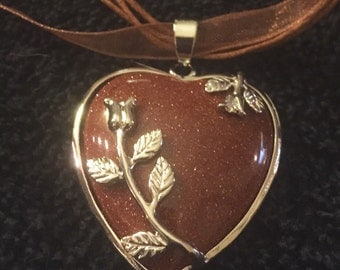 Goldstone heart silver leaves pendant on brown organza ribbon