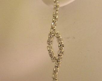 Silver-tone Prong Set Rhinestone Dangle Pierced Earrings. Item:E818462
