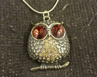 necklace gold colored chain and mutli-colored owl