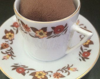 Brown flowered teacup pincushion