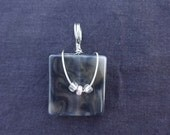 Simple, Chic Gray Square pendant wrapped in Silver wire with pretty accent beads. Simple but stylish!