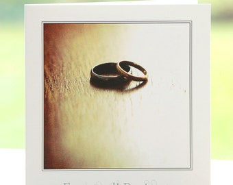 Silver/platinum and gold wedding/engagement/civil partnership rings photograph, blank inside, square greetings card