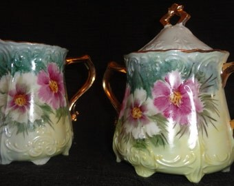 Japan porcelian hand painted cosmos flowered covered sugar and creamer footed ex used cond Lovely gilt accents